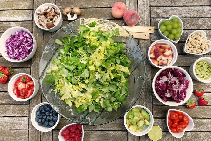 table full of salad ingredients