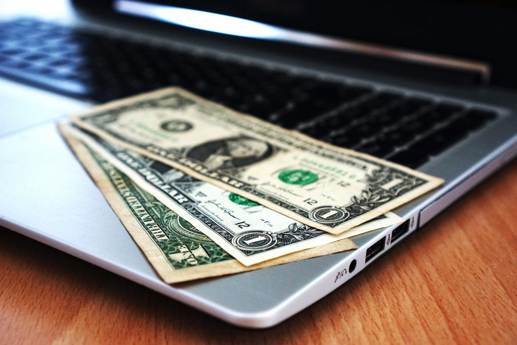 money sitting on computer
