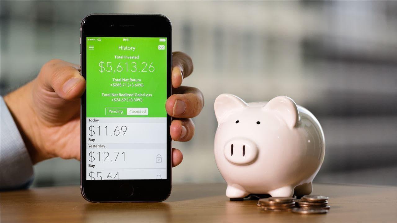 phone next to Piggy bank