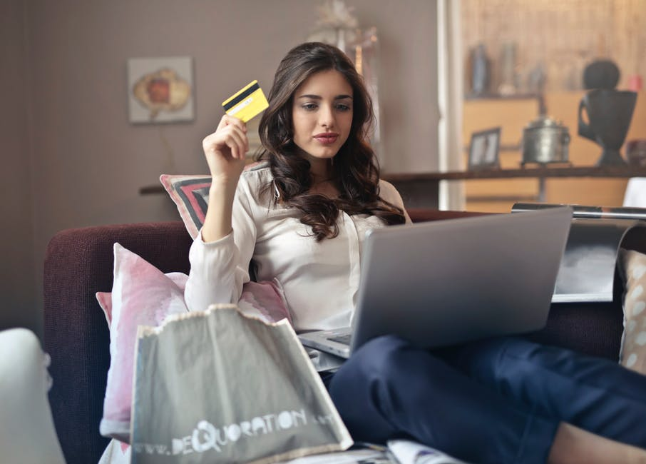 girl shopping on computer with credit card